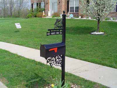 Wrought iron mailbox post with vines