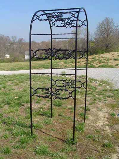 Wrought iron arbor with ornament